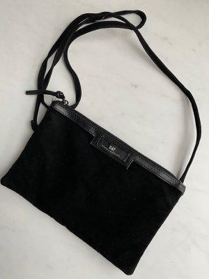Tasche kann auch als Clutch getragen werden