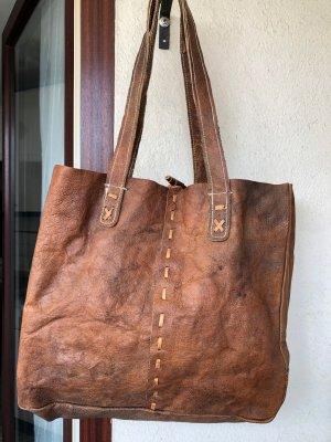 Comprador coñac-marrón