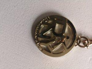 DKNY Llavero color oro