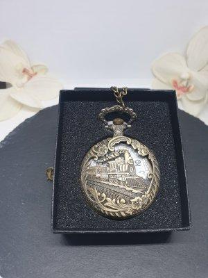 Reloj con pulsera metálica color bronce