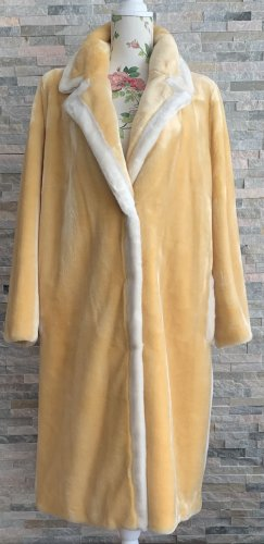 Stand Cappotto in eco pelliccia giallo pallido-bianco
