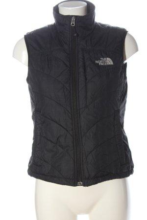 The North Face Chaleco deportivo negro estampado acolchado look casual
