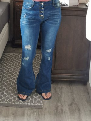 Jeansowe spodnie dzwony niebieski Bawełna