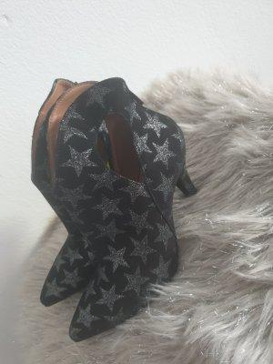 Vera Pelle Patucos con punta abierta negro