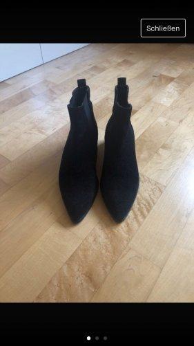 Botines estilo vaquero negro