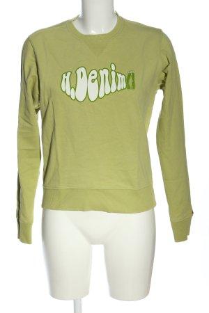 Tommy Hilfiger Suéter verde letras impresas look casual