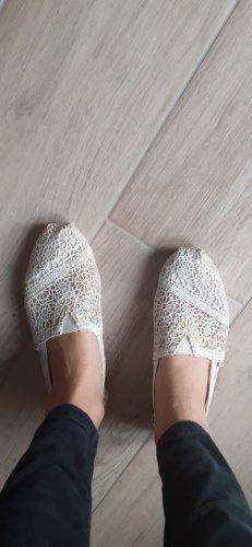 Toms Schuhe mit creme blumenmuster
