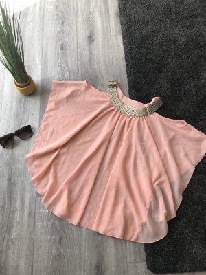 Camisa de un solo hombro rosa
