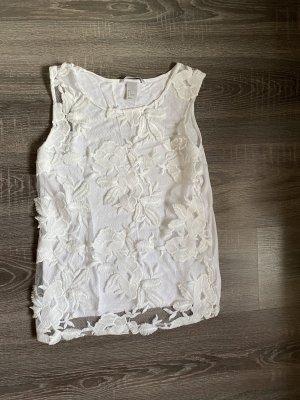Top di merletto bianco