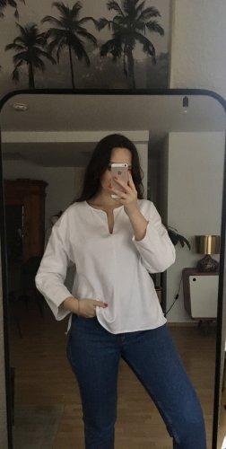 COS Camisa con cuello V blanco