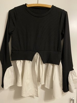 Top peplum negro-blanco
