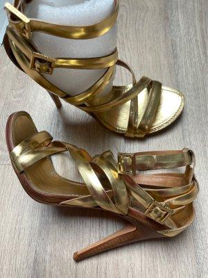 Tory Burch Sandalias de tacón alto color oro