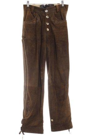 Pantalone in pelle tradizionale marrone motivo floreale look vintage
