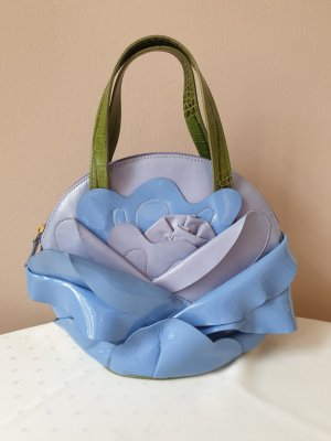 Trendig violett-hellblaue Braccialini Lederhandtasche