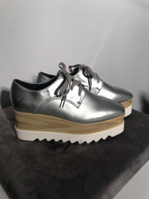 Scarpa stringata argento-bianco