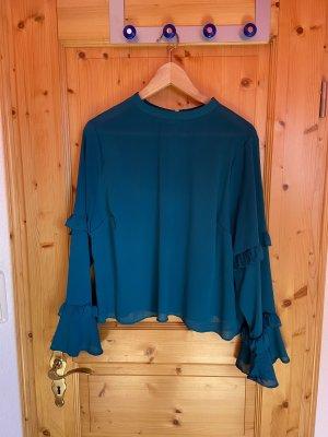 türkis-blaue Bluse
