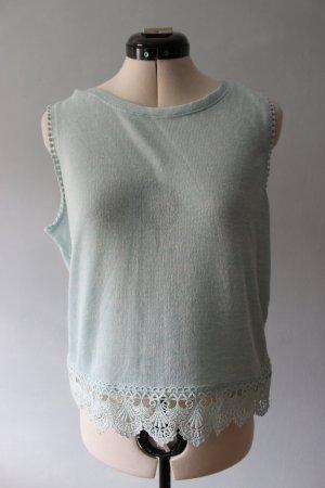 Türkisblauer Pullover ohne Ärmel