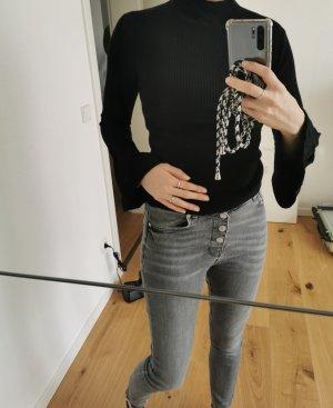 Turtleneck Pullover mit Trompetenärmeln