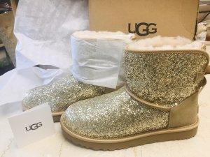 UGG Botas de nieve color oro