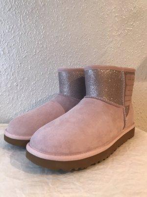 UGG Botas de piel rosa empolvado