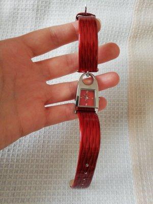 Reloj analógico rojo