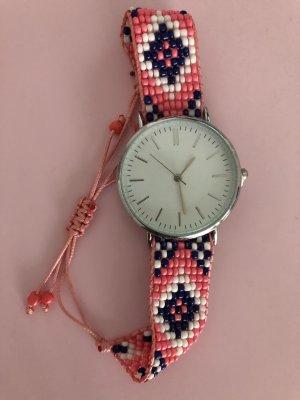 Reloj analógico multicolor