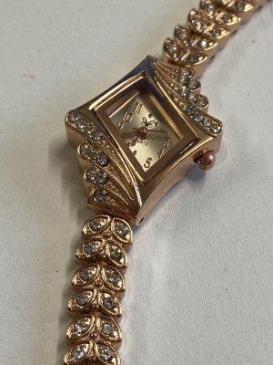 Montre avec bracelet métallique or rose