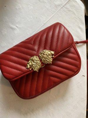 Zara Riñonera color oro-rojo oscuro