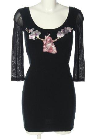 Alma Gemelli Falda estilo lápiz negro estampado temático look casual