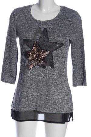 Glanzende blouse zwart-wit gestippeld casual uitstraling