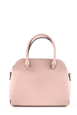 Bolso barrel rosa look casual