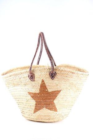 Bolso tipo cesta crema-marrón estampado temático look casual