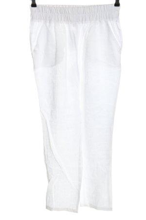 Pantalón de lino blanco look casual