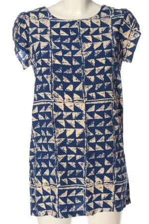 Blusa larga azul-crema estampado repetido sobre toda la superficie look casual