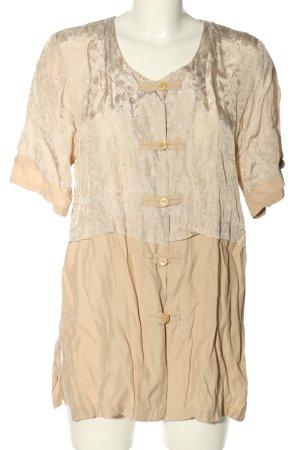 Blusa larga crema elegante