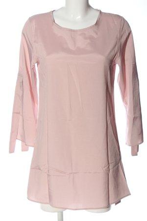 Blusa larga rosa elegante