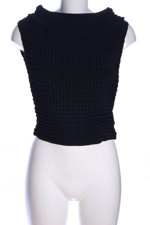 Blusa sin mangas negro punto trenzado look casual