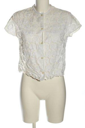 Blusa de encaje blanco look casual