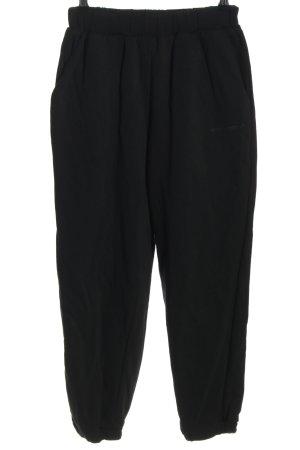Monochrom Sweat Pants black printed lettering casual look