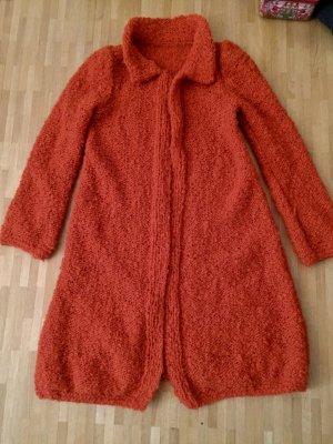 Manteau en tricot rouille-orange fluo