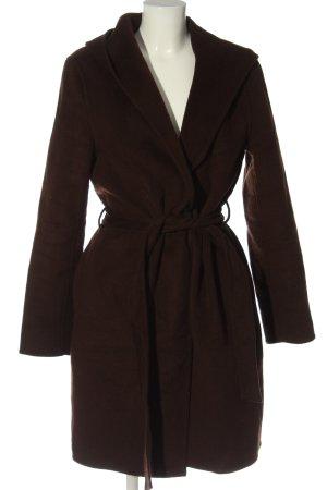 Uniqlo Abrigo con capucha marrón look casual