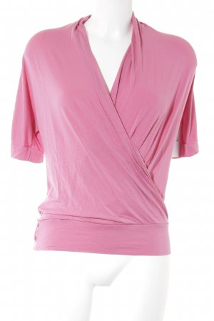 Usha Camisa cruzada rosa look Street-Style