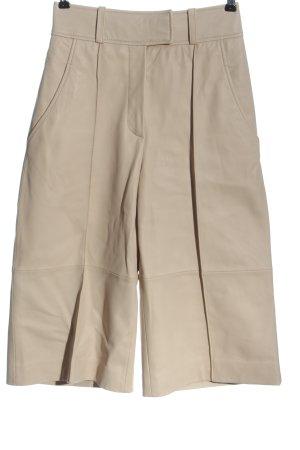 Uterqüe Pantalone in pelle crema stile casual