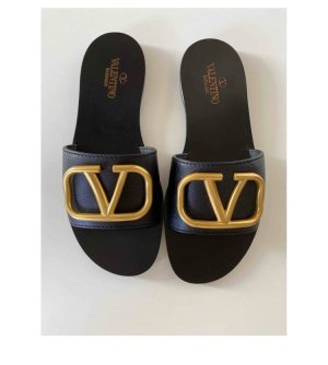 Valentino Garavani Leder Vlogo Flats Sandalen Pantoffeln Gold schwarz Ausverkauf 36 37