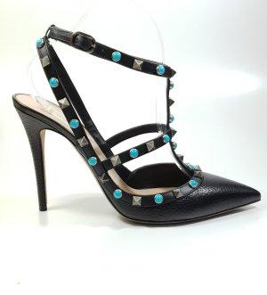 C. Valentino Strapped pumps black