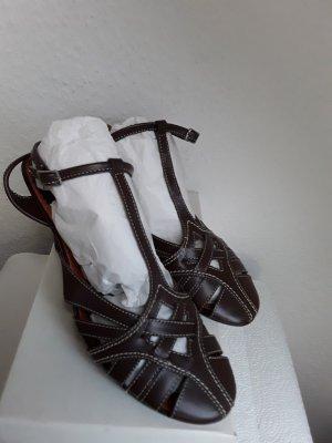 Vera Pelle Sandalias de tacón con barra en T marrón oscuro Cuero