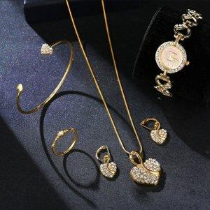 Reloj con pulsera metálica color oro