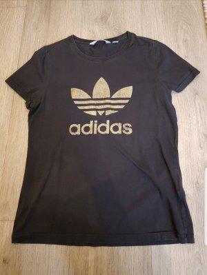 Verkaufe schönes Adidas T-Shirt in schwarz-gold.