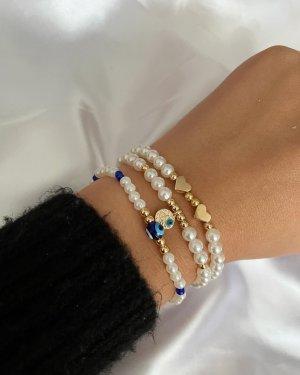 Bracelet en perles blanc-doré