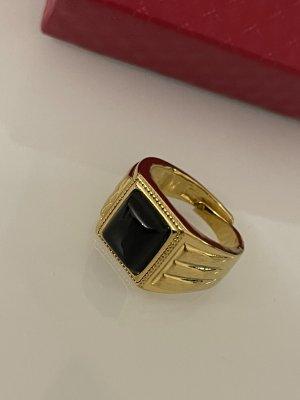 verstellbarer siegelring in gold mit schwarzem stein